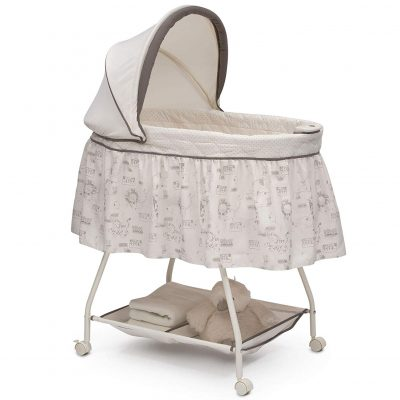 Baby bassinet featuring calming nightlight and soothing music.