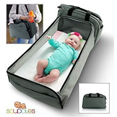 Travel Bassinet Functions As Diaper Bag And Changing Station